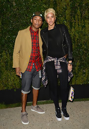Pharrell Williams paired this tan blazer over a red plaid button down for a cool and hip look at the Chanel Dinner for NRDC.