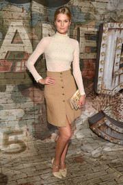 Toni Garrn went for a cream embellished bodysuit for a Chanel dinner.