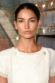 Lily Aldridge attended the Chanel dinner and cocktails wearing her hair in a simple bun.