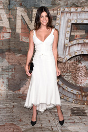 Julia Restoin-Roitfeld was equal parts angelic and sexy at the Chanel dinner in a white cocktail dress with a cleavage-baring neckline and a high-low hem.