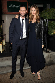 Behati Prinsloo was tough-glam in a flowy navy evening dress and a black leather jacket at the 'Begin Again' dinner.