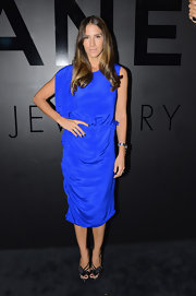 Minnie Mortimer was the most colorful at the occasion in her bright blue silk dress. The asymmetrical design was lovely with those bowed sandals.