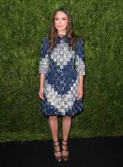 Keira Knightley looked regal in a blue and silver checkered coat dress while attending the Chanel dinner in her honor.