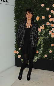 Kara Yoshimoto Bua was classic Chanel chic at the soiree in LA. She topped off her tweed jacket with black leather ankle boots.