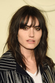 Isabella Manfredi attended the Chanel Paris-Salzburg show wearing an edgy wavy 'do with wispy bangs.