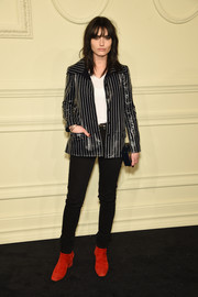 Isabella Manfredi topped off her edgy outfit with a black-and-white striped leather jacket.