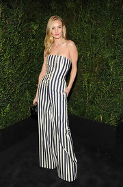 Rosie went for a bold graphic look in this striped strapless wide-leg jumpsuit at the Chanel soiree.