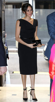 Meghan Markle was svelte and elegant in a Black Halo midi dress with an asymmetrical neckline at CHOGM London 2018.