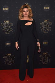 Shania Twain flaunted her fit figure in a black cutout jumpsuit by La Petite Robe di Chiara Boni at the CMT Artists of the Year event.