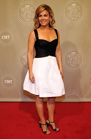 Cat Cora paired a black and white color block dress with glimmering black heels. The crystal-embellished sandals matched her dazzling earrings.