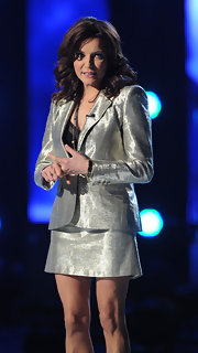 Martina goes metallic in this shimmering skirt suit at the CMT Artists of the Year Show.
