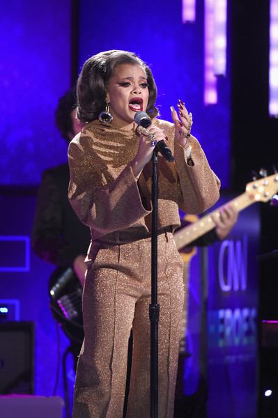 Andra Day performed at the 2017 CNN Heroes show wearing a loose gold crop-top and matching trousers.
