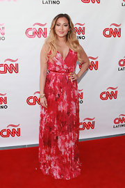 Adrienne Bailon chose this long red tie-dye maxi with a pleated skirt for her look at the CNN en Espanol upfront event.