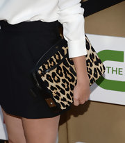 Robin's leopard print clutch added a bold statement to her black and white ensemble.