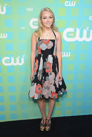 Annasophia Robb paired her pretty floral sundress with black sandals featuring metallic gold edging.