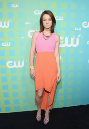 Jessica Stroup was colorful at the CW Upfront event in this tangerine fishtail skirt.