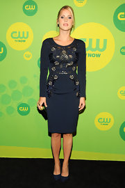 Claire Holt's dark navy long-sleeve dress featured fun embroidery on the bodice for a sleek and sophisticated look.