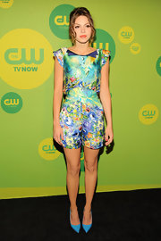 Aimee Teegarden rocked a floral watercolor romper with puffed sleeves at the CW Upfront Event in NYC.