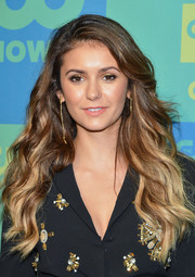 Nina Dobrev topped off her look with a super-long pair of gold dangle earrings by Lina Noel.