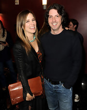 Sophia Bush added earthiness to her style with an oversize cognac clutch.
