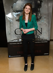 Rose Leslie's leggings kept her green blazer and black booties looking simple and sleek.