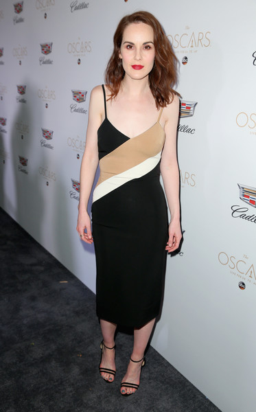 Michelle Dockery teamed her dress with strappy black sandals.