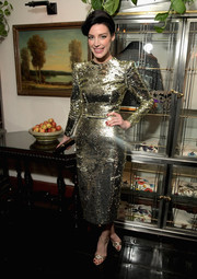 Jessica Pare matched her dress with gold ankle-strap sandals.