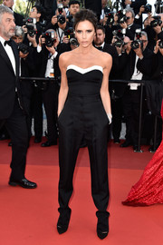 Victoria Beckham paired her pants with a black-and-white tube top, also from her own line.