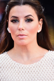 Eva Longoria drew attention to her eyes with glittery gold shadow when she attended the Cannes opening gala.