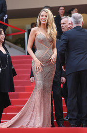 Blake Lively cut a curvy silhouette in a Versace fishtail gown with chainmail panels and illusion inserts during the Cannes opening gala.