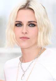 Kristen Stewart worked a punky platinum-blonde hairstyle at the 'Cafe Society' photocall.