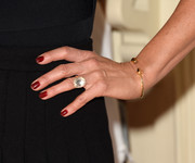 Jennifer Aniston's red mani popped against her black outfit at the TIFF premiere of 'Cake.'