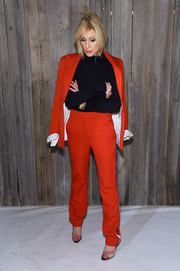 Judith Light was sporty-chic in a red side-striped pantsuit at the Calvin Klein fashion show.