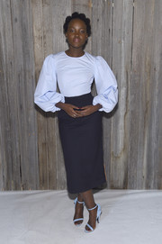 Lupita Nyong'o matched her blouse with a pair of baby-blue Calvin Klein sandals.