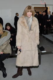 Anna Wintour bundled up in glam style with a beige fur coat during the Calvin Klein fashion show.
