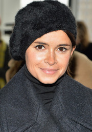 Miroslava Duma attended the Calvin Klein fashion show wearing a fluffy black wool beret.