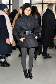 Miroslava Duma cut a strong silhouette in a bulky charcoal wool coat during the Calvin Klein fashion show.