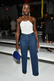 Lupita Nyong'o looked summery in a textured white cami by Calvin Klein during the label's fashion show.