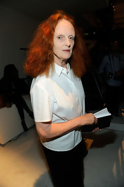 Grace Coddington looked classic in a short-sleeve white button down shirt at the Calvin Klein Spring 2012 fashion show.