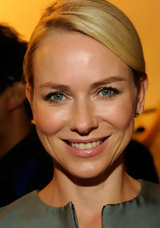 Naomi Watts opted for a soft, neutral makeup palette at the Calvin Klein Spring 2012 fashion show. She chose a shimmery pink lipstick with a hint of shine to accentuate her mouth.