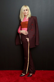 Judith Light teamed a burgundy pantsuit with a color-block sweater for the Calvin Klein Spring 2019 show.