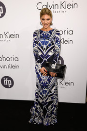 Hofit Golan looked exuberant in a printed evening dress during the Calvin Klein party in Cannes.