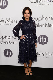 Miroslava Duma was quirky-glam in a navy Calvin Klein dress, featuring a ruffle neckline and silver polka dots, during the brand's party in Cannes.