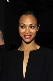 Zoe Saldana added a classic touch to her minimalist look with a 14-karat gold and diamond necklace.