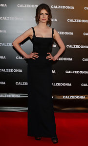 Tali Lennox struck a pose in a form-fitting evening dress at a Calzedonia event in Rimini, Italy.