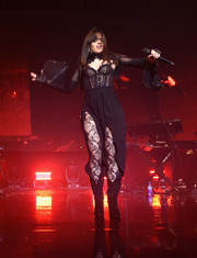 Camila Cabello looked seductive in a black lace corset by Agent Provocateur while performing in New York City.