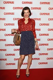 Milla Jovovich paired her playful multi-printed ensemble with classic black peep-toe pumps.
