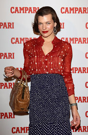 Milla Jovovich charmed at the unveiling of Campari's 2012 calender in a flirty retro red and white polka dot blouse.