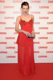 Milla Jovovich wore an orange red silk gown with a beaded bustier for the Campari event.