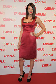 Asia Argento looked stunning in a red satin silk dress at the unveiling of Campari's 2012 calendar.